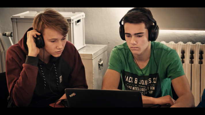 two male teenagers with headphones